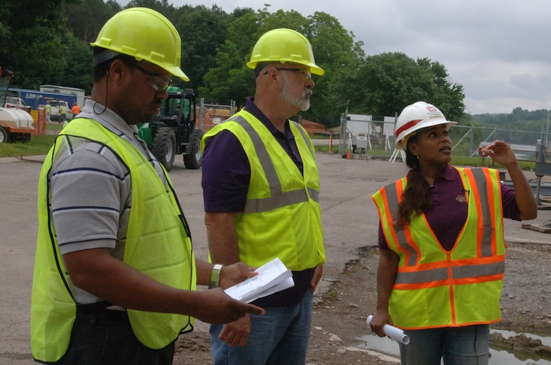 Debbie Dowell, U.S. Army Corps of Engineers Nashville District Mid Cumberland Construction Office project engineer, talks about ongoing construction of a new lock operator building with Victor Bright (Left), history teacher, and Harold Cunningham, construction teacher, both from Cane Ridge High School, at Cheatham Dam in Ashland City, Tenn., June 6, 2013.