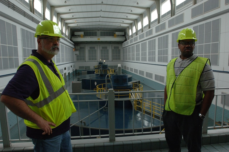 Victor Bright (Right), history teacher, and Harold Cunningham, construction teacher, learn about how the Corps produces clean energy during a tour of the Cheatham Dam Hydropower Plant in Charlotte, Tenn., during a tour June 6, 2013.  The Cane Ridge High School teachers were participating in an externship with the Corps to develop project based learning curriculum.