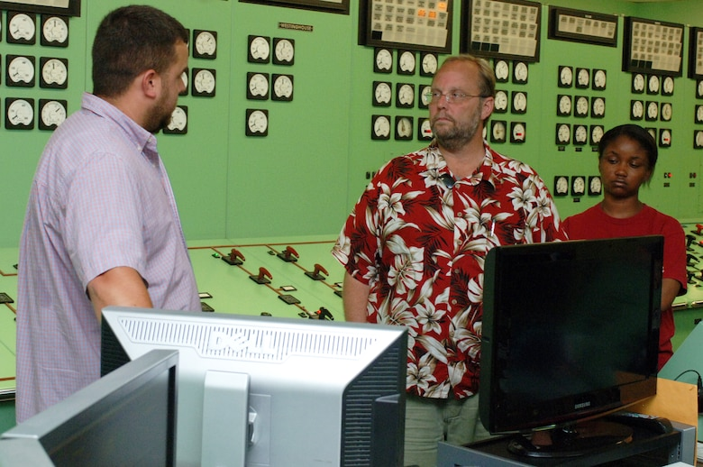 Dirk Cundiff (Left), U.S. Army Corps of Engineers Nashville District journeyman operator, explains how the Corps provides clean energy at the Old Hickory Dam Hydropower Plant June 12, 2013 while giving a tour to Big Picture High School Teachers Wayne Birch and Lakeshia Wright.  The Corps was participating in a teacher externship to help teachers develop project based learning curriculum.