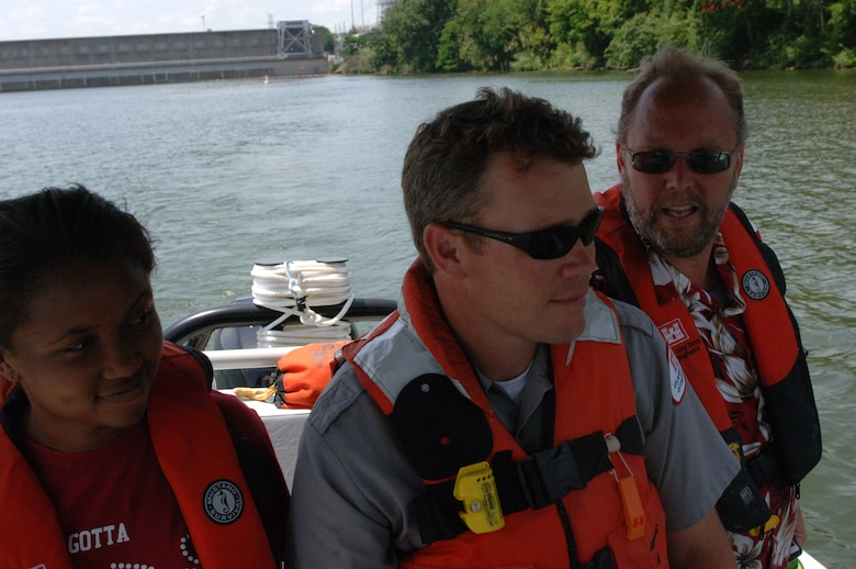Old Hickory Lock Park Ranger Charlie Leath (Center), U.S. Army Corps of Engineers Nashville District, pilots a patrol boat just upstream of Old Hickory Dam June 12, 2013 to show Big Picture High School Teachers Lakeshia Wright and Wayne Birch how the water can cause erosion to the shoreline.  The Corps was participating in a teacher externship to help teachers develop project based learning curriculum.