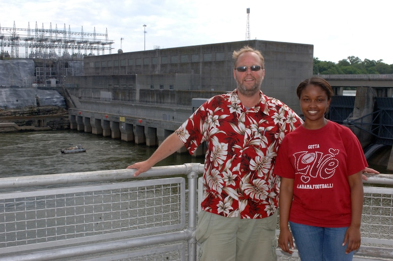 Big Picture High School Teachers Wayne Birch and Lakeshia Wright pose with Old Hickory Dam Hydropower Dam and Power Plant behind them.  They were standing on the navigation lock of the Cumberland River, which puts them in Old Hickory, Tenn., June 12, 2013.  The teachers were participating in a teacher externship program with the U.S. Army Corps of Engineers Nashville District to help develop project based learning curriculum.  The Nashville District works with schools, teachers and students involved in science, technology, engineering and mathematics programs.