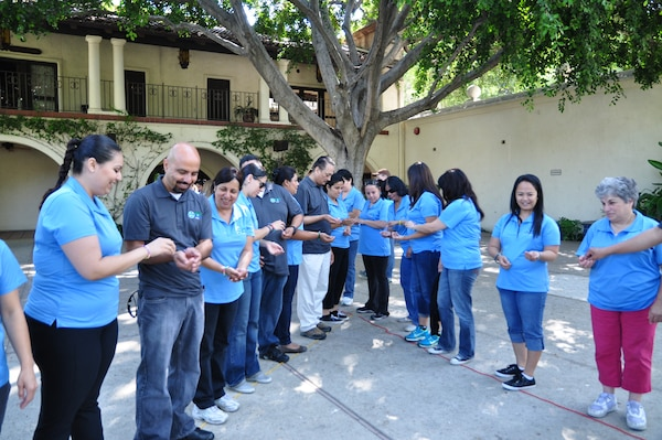 Teachers from among 20 schools in the Boyle Heights neighborhood of Los Angeles gathered the week of June 24 to learn techniques for incorporating hands-on activities related to science, technology, engineering and math. In this photo they are learning about how water flows within a watershed.