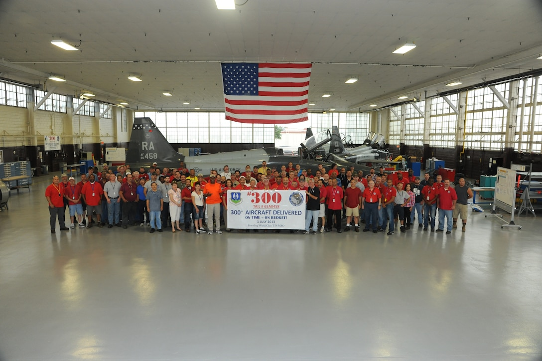 Members of the 571 Aircraft Maintenance Squadron Operating Location-Alpha celebrate the completion of their 300th T-38 Talon July 1 at Joint Base San Antonio-Randolph. The 571 AMXS OL-A started work at JBSA-Randolph in October 2010 as a separated unit from the 309 Aircraft Maintenance Group at Hill Air Force Base, Utah. The team is charged with maintenance, repair and overhaul of all T-38 Talon aircraft in the Air Force inventory. (U.S. Air Force photo by Don Lindsey)