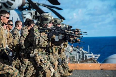 Marines of the Force Reconnaissance Platoon, 31st Marine Expeditionary Unit, conduct a small-arms, live-fire exercise on the port aircraft elevator here, June 29.  The 31st MEU is currently underway with Amphibious Squadron 11, beginning their summer patrol. The 31st MEU is the Marine Corps' force in readiness for the Asia Pacific region and the only continuously forward-deployed MEU.