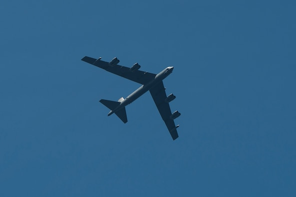 A B-52 Stratofortress flies over USS Preble (DDG 88), an Arleigh Burke-class guided-missile destroyer, June 24, 2013, following an electronic warfare exercise during Pacific Bond 2013. Pacific Bond 2013 was a U.S. Navy, Royal Australian Navy and Japan Maritime Self Defense Force maritime exercise designed to improve interoperability and further relations between nations. (U.S. Navy photo by Mass Communication Specialist 3rd Class Paul Kelly/Released)