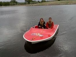 """Many District recreation areas sponsor """"miniboats"""" where, after related safety instruction from the Corps and partner agencies, students get to take small electric boats through an obstacle course on the water."""