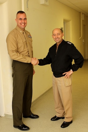 Admiral James G. Stavridis, the supreme allied commander for Europe and commander of U.S. European Command shakes hands with Lt. Col. Rick Coates, future/current operations officer for Marine Forces, Europe during his tour of the Marine Corps Forces, Europe and Africa headquarters building. Stavridis walked the halls of the headquarters, stopping to talk to Marines and civilians. This was his last stop before returning to NATO headquarters in Belgium.