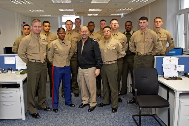 Admiral James G. Stavridis, the supreme allied commander for Europe and commander of U.S. European Command shakes poses with Marines assigned to the Marine Corps Forces, Europe, G-1 personnel section, during his tour of the Marine Corps Forces, Europe and Africa headquarters building. Stavridis walked the halls of the headquarters, stopping to talk to Marines and civilians. This was his last stop before returning to NATO headquarters in Belgium.