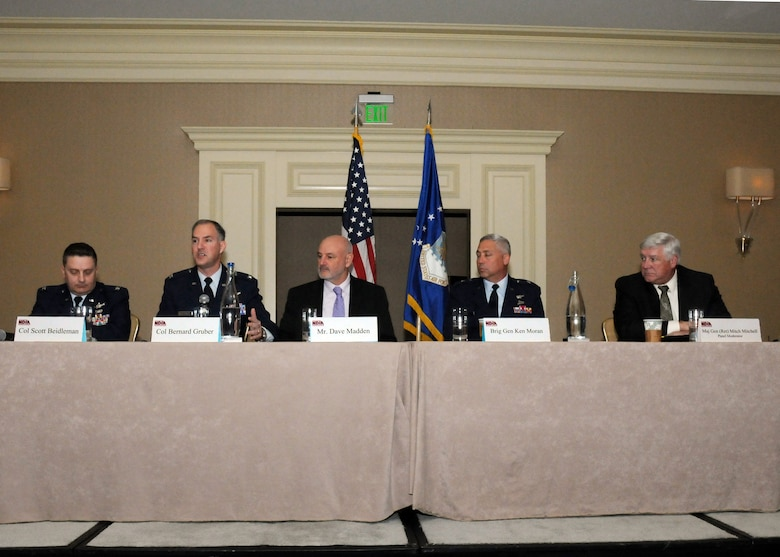 Senior Space and Missile Systems Center leaders participate in a panel discussion about Maintaining America's Space Advantage at the National Defense Industrial Association's Acquisition Forum held in Marina Del Rey, Calif., Feb. 22.  Pictured from left to right are: Col. Scott Beidleman, Developmental Planning director; Col. Bernard Gruber, Global Positioning Systems director; Dave Madden, SMC executive director, Brig. Gen. Ken Moran, Program Management and Integration director; and Mitch Mitchell, The Aerospace Corporation vice president of Program Assessments. (Photo by Jim Gordon)