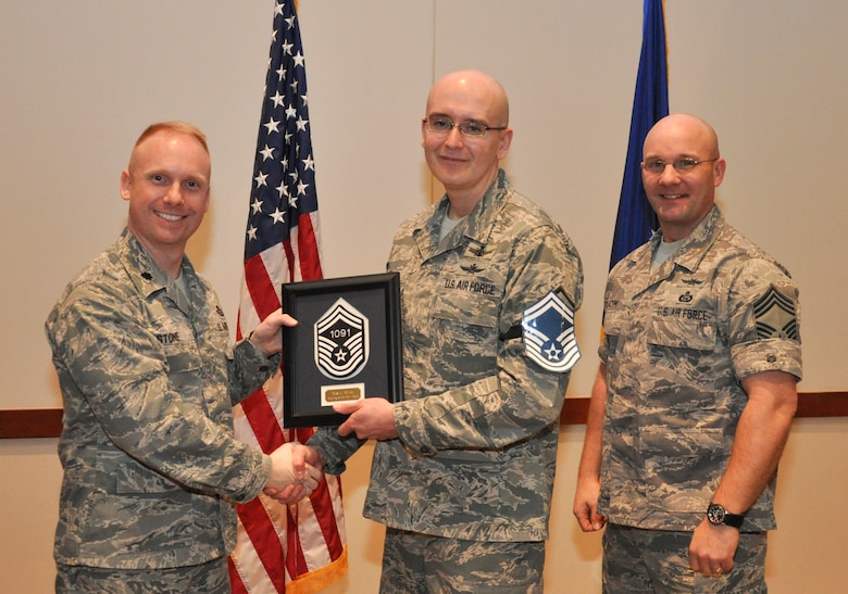 Master Sgt. Ray Miller, 566th Intelligence Squadron, is recognized for promotion selection by Lt. Col. Adam Stone, 566th IS commander, and Chief Master Sgt. Edward Slacum, 566th IS superintendent, during a promotion release party Feb. 28, 2013, at the Leadership Development Center on Buckley Air Force Base, Colo. Miller is one of six Team Buckley senior master sergeants selects. (U.S Air Force photo by Staff Sgt. Nicholas Rau/Released)