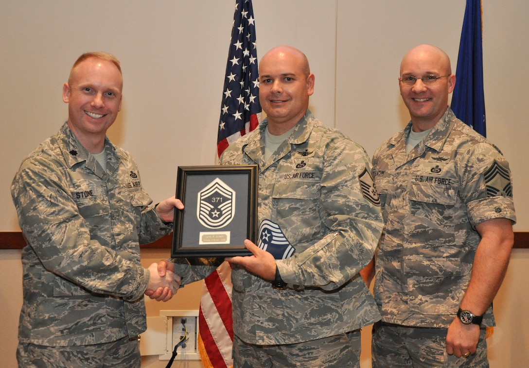 Master Sgt. Terry Burson, 566th Intelligence Squadron, is recognized for promotion selection by Lt. Col. Adam Stone, 566th IS commander, and Chief Master Sgt. Edward Slacum, 566th IS superintendent, during a promotion release party Feb. 28, 2013, at the Leadership Development Center on Buckley Air Force Base, Colo. Burson is one of six Team Buckley senior master sergeants selects. (U.S Air Force photo by Staff Sgt. Nicholas Rau/Released)