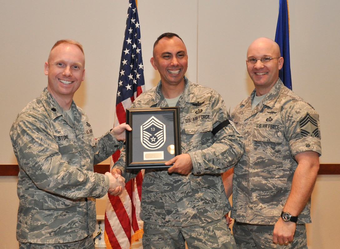 Master Sgt. Edward Cutshaw, 566th Intelligence Squadron, is recognized for promotion selection by Lt. Col. Adam Stone, 566th IS commander, and Chief Master Sgt. Edward Slacum, 566th IS superintendent, during a promotion release party Feb. 28, 2013, at the Leadership Development Center on Buckley Air Force Base, Colo. Cutshaw is one of six Team Buckley senior master sergeants selects. (U.S Air Force photo by Staff Sgt. Nicholas Rau/Released)