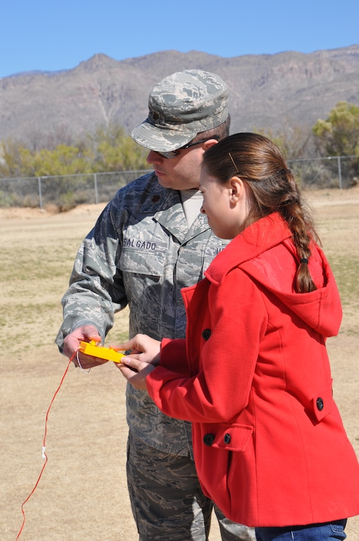 "Maj. Daniel Salgado, 612th Air and Space Operations Center, instructs a 5th grade student on ""how to launch a rocket"" during a demonstration at Tanque Verde Elementary School in Tucson, Ariz., March 1. Airmen from 12th Air Force (Air Forces... Southern) gave 5th grade students a lesson on space operations (launch operations, weather support, launch control centers and the importance of launch observation and recovery) during their visit. (USAF photo by Master Sgt. Kelly Ogden/Released)."