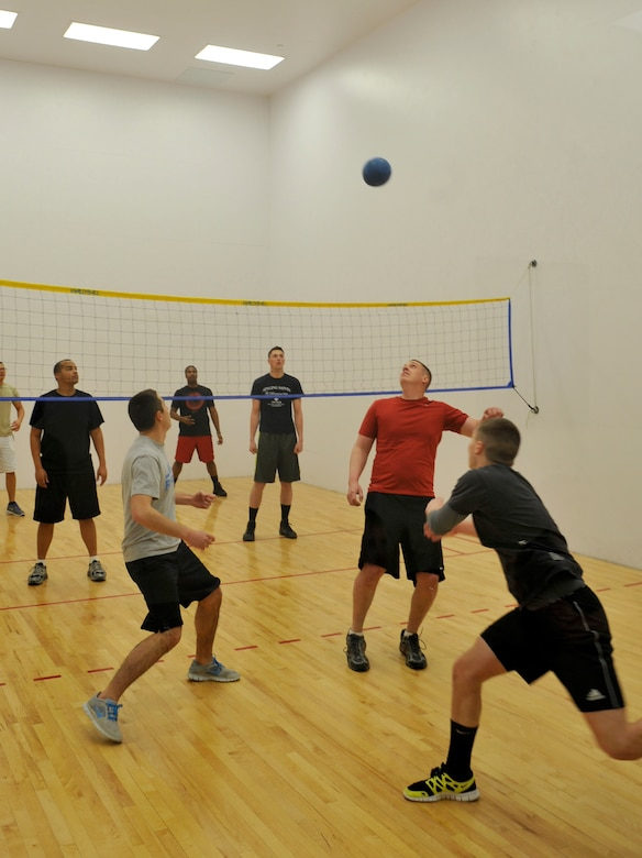 The 460th Force Support Squadron Wallyball Team members volley the ball to the opposing team at the Buckley Wallyball Tournament Feb. 28, 2013, at the fitness center, Buckley Air Force Base, Colo. Eight teams of four to six players competed in a double-elimination style tournament. (U.S. Air Force photo by Airman 1st Class Riley Johnson/Released)