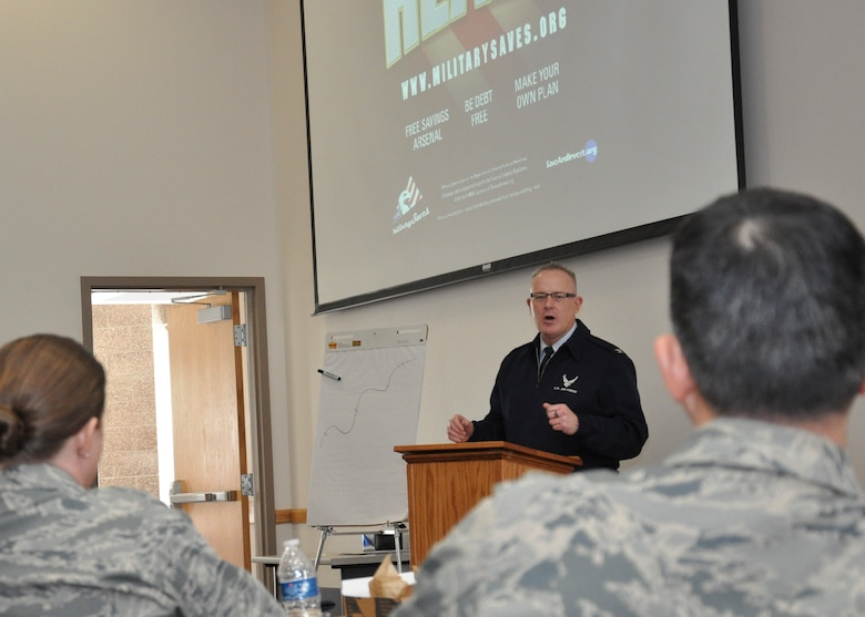 Col. Dan Dant, 460th Space Wing commander, gives closing comments during a financial symposium March 1, 2013, at Bldg. 606, Buckley Air Force Base, Colo. Team Buckley members had the chance to sit in on various financial seminars, where investing, dumping debt and consumer smarts were some of the topics covered. (U.S. Air Force photo by Senior Airman Christopher Gross/Released)