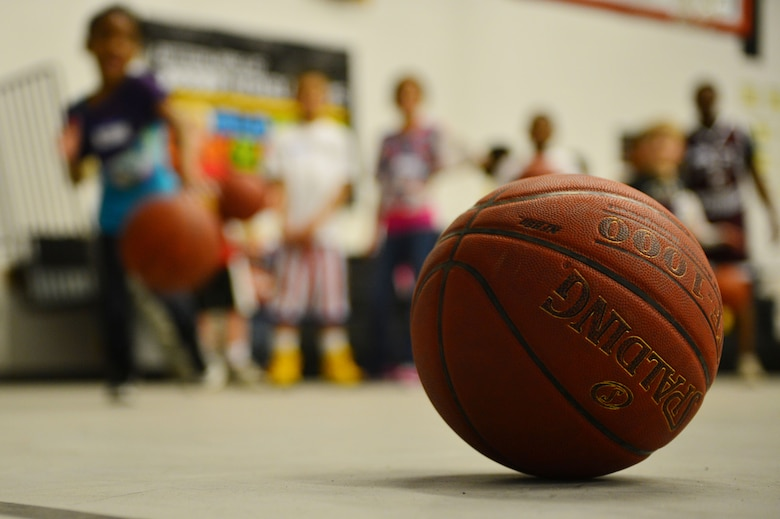 Twelve children participated in a youth basktball clinic held in the Youth Center at Cannon Air Force Base, N.M., Feb. 26, 2013. Cannon's men's varsity basketball team hosted a youth basketball clinic for children, ages 6-11, to teach them standard fundamentals of the game. (U.S. Air Force photo/Airman 1st Class Eboni Reece)