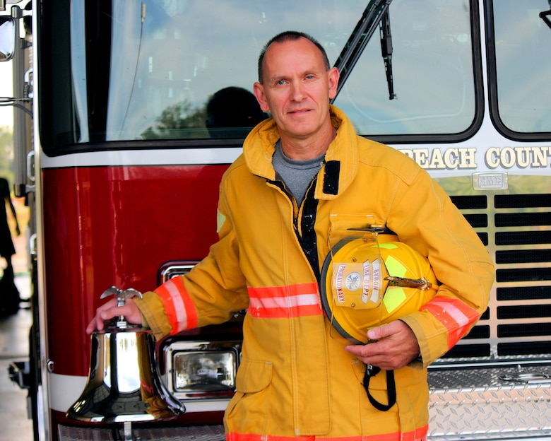 National Guard Master Sgt. Todd, from the 116th Air Control Wing (ACW), stands in front of a fire truck in Byron, Ga., Oct. 4, 2012.  Todd, a fulltime Guardsman with the 116th ACW, completed level-one fire fighter training to become a volunteer fire fighter in his community.(Contributed Photo/Released)