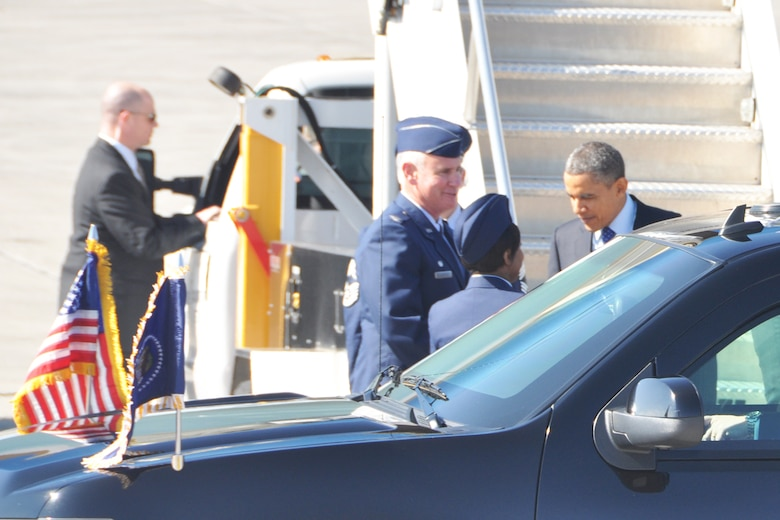 Col. Steven R. Clayton, 94th Operations Group commander and Senior Airman Tumyra D. Byron, knowledge management specialist, greet President Barack Obama during his visit to Dobbins Air Reserve Base, Feb. 14. The president was en-route to the City of Decatur Recreation Center to discuss proposals outlined in his recent state of the union address. Bryon received a President's Coin from Obama during the visit. (U.S.Air Force photo/James Branch)