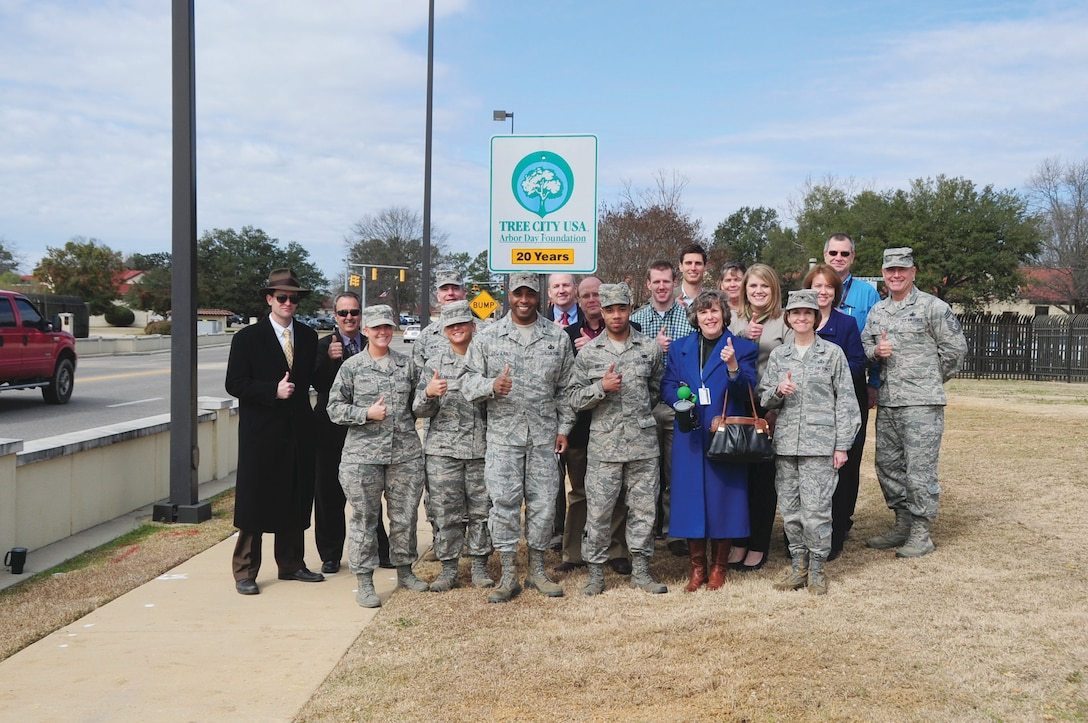In celebration of Maxwell's 20th consecutive Tree City USA award, base and city leadership, volunteers and visitors taking part in the Arbor Day event witnessed the replacement of the Tree City USA marker by the Bell Street gate's visitor center. (U.S. Air Force photo by Staff Sgt. Sandra Percival)