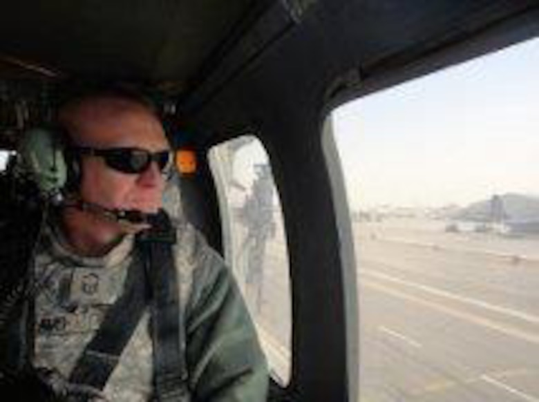 Senior Master Sgt. David Williams, 366th Security Forces Squadron operations superintendent, poses in a helicopter prior to a battlefield circulation, during his last deployment to Kandahar Airfield, Afghanistan. Williams was assigned as the 820th Base Defense Group security superintendent, where he streamlined International Security Assistance Force manpower requirements. He was also the battle captain managing joint force responses to indirect fire and improvised-explosive device attacks. (Courtesy photo)