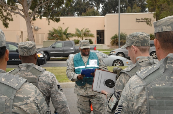 Master Sgt. Jeromee Tate briefs a team of combined Airmen known as Chalk 6 during a prepare the force exercise for an upcoming ORI (Operational Readiness Inspection) at the 146th Airlift Wing located in Port Hueneme, Calif. March 3, 2012. (U.S. Air Force photo by: Senior Airman Nicholas Carzis)