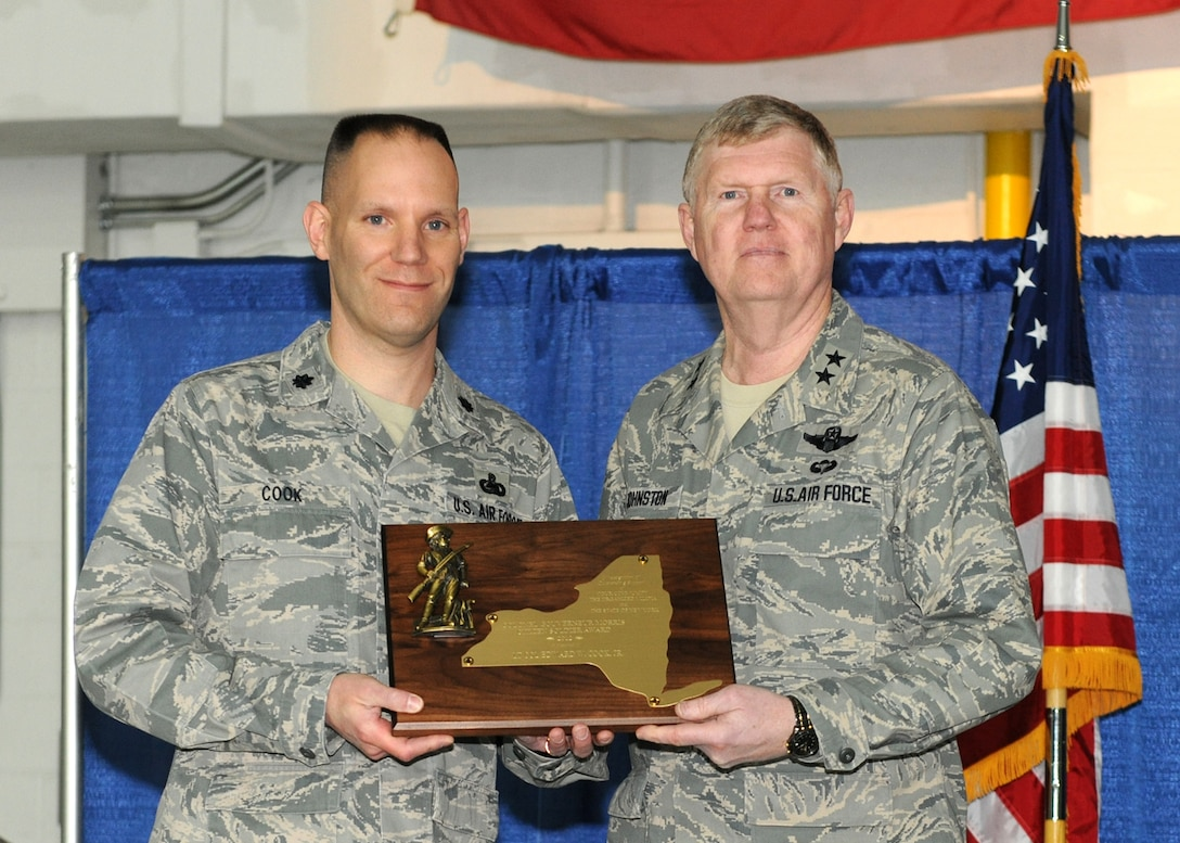 New York Air National Guard Commander Maj. Gen. Verle L. Johnston (right) presents Lt. Col. Edward W. Cook, 174th Attack Wing Logistics Readiness Squadron Commander, with the Colonel Governour Morris Citizen Soldier Award at Hancock Field, Syracuse NY on 3 March 2013. The award is presented annually to a member of the New York State Organized Militia who has distinguished himself through outstanding support to the New York National Guard and his local community. (NYANG photo by Tech. Sgt. Justin Huett/Released)