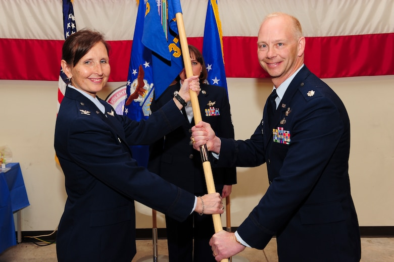 U.S. Air Force Col. Traci L. Kueker-Murphy, 310th Operations Group commander, hands the 379th Space Range Squadron guidon to U.S. Air Force Lt. Col. Clifton D. Stargardt in Colorado Springs, Colo., Mar. 3, 2013. Stargardt assumed command during the official activation ceremony of the 379 SRS.  (U.S. Air Force photo by Tech. Sgt. Nicholas B. Ontiveros/Released)