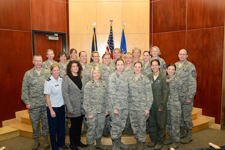 The keynote speaker at the Utah Air National Guard's Women's History Month celebration, Col. Christine Burckle, poses with some audience members after her presentation on base, March 3. In her presentation, Burckle highlighted women's roles throughout military history and offered advice to women who currently serve. (U.S. Air Force photo by TSgt. Jeremy Giacoletto-Stegall)(RELEASED)