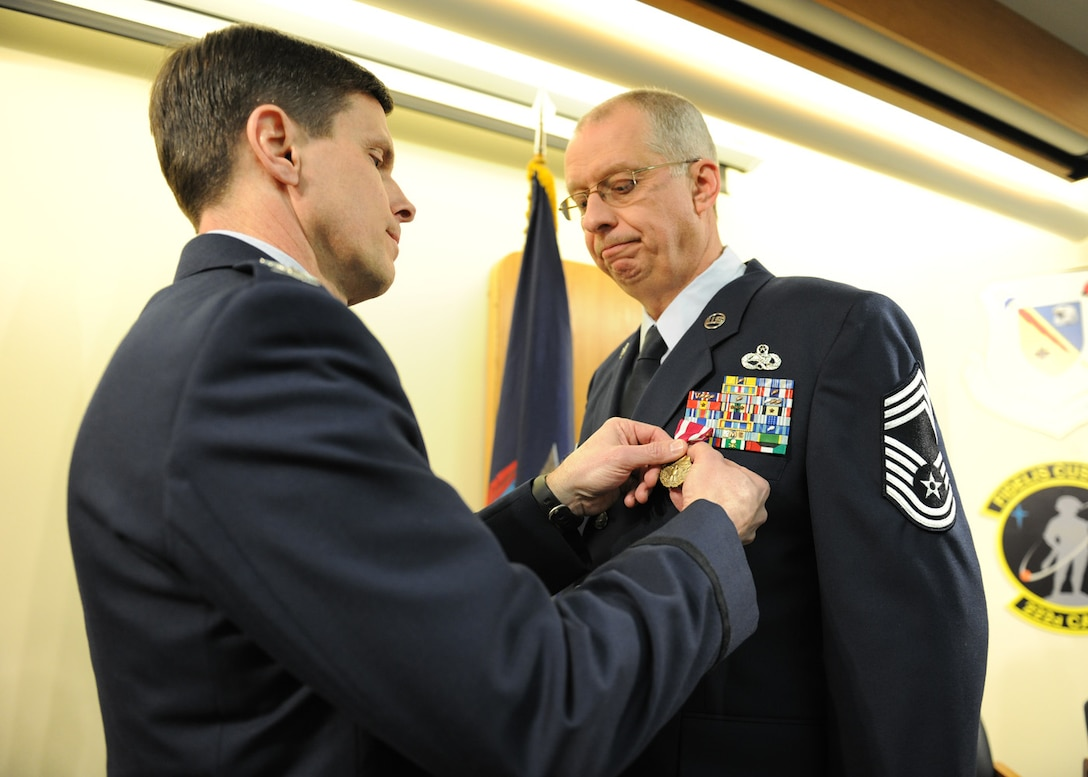 New York Air National Guard Chief Master Sgt. James Thomas (right) receives the Meritorious Service Medal from NYANG Col. Greg Semmel, 174th Attack Wing Commander, at Hancock Field Air National Guard Base, Syracuse, New York on 2 March 2013.  Thomas received the award as a part of his retirement ceremony after more than 35 years of service in the military. (NYANG photo by Tech. Sgt. Jeremy M. Call/Released)
