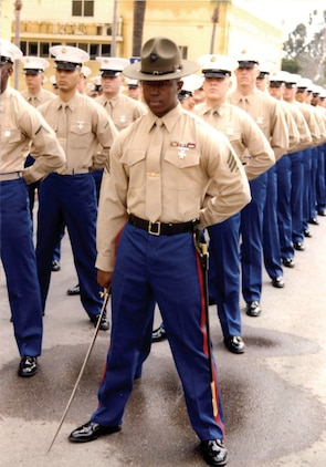 Sergeant Lorenzo Lacy leads his platoon as a senior drill instructor on Marine Corps Recruit Depot, San Diego. Lacy picked up staff sergeant meritoriously on the drill field.