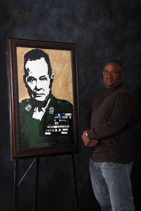 Anthony Plummer, a maintenance worker with Installation and Logistics Division on Marine Corps Logistics Base Barstow, stands with a painting of Lt. Gen. Lewis 'Chesty' Puller he donated to the MCLB Barstow Historical Gallery, Feb. 26. While not at work