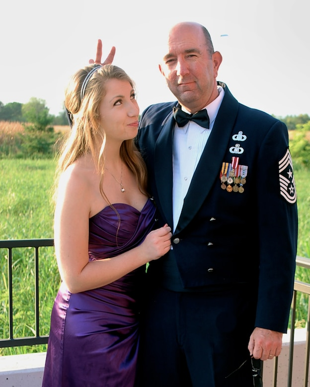Chief Master Sgt. Jeffrey Craver, 31st Fighter Wing command chief, jokes around with his daughter on the porch of his house. For 18 years, his daughter has associated the military uniform with that of safety, security, dignity, trust and respect. However, with more than 700 sexual assaults reported across the Air Force in 2012, the uniform can be a fearful reminder that their brothers or sisters in arms assaulted them. (Courtesy Photo)