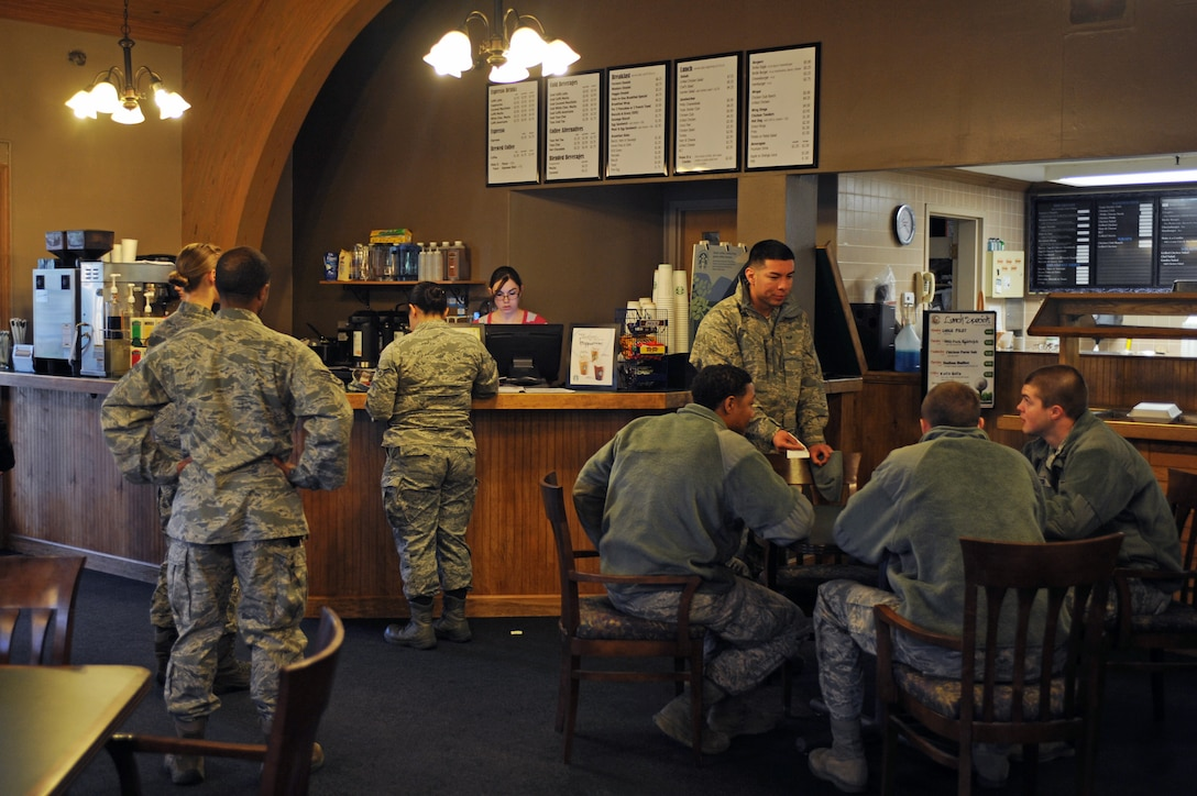U.S. Air Force Airmen assigned to the 4th Fighter Wing sip coffee and converse at the newly opened Starbucks located in the Three Eagles Café on Seymour Johnson Air Force Base, N.C., Mar. 1, 2013. Starbucks is open Monday through Friday from 6:30 a.m. to4:30 p.m., and Saturday and Sunday from 6:30 a.m. to 2 p.m. (U.S. Air Force photo/Airman 1st Class John Nieves Camacho/Released)