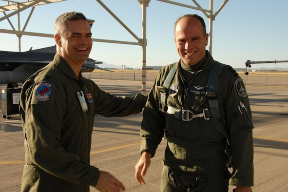 Royal Netherlands Air Force Lt. Col. Maurits Schonk, Commander of the Netherlands Detachment at the 148th Fighter Squadron, is greeted by Maintenance Group Commander Col. Andrew MacDonald at the 162nd Fighter Wing in Tucson, Ariz., October 29, 2010. Lt. Col. Schonk had just delivered the first of ten Dutch F-16 Fighting Falcons to the Wing to be used for pilot training. (U.S. Air Force photo by Master Sgt. David Neve/Released)