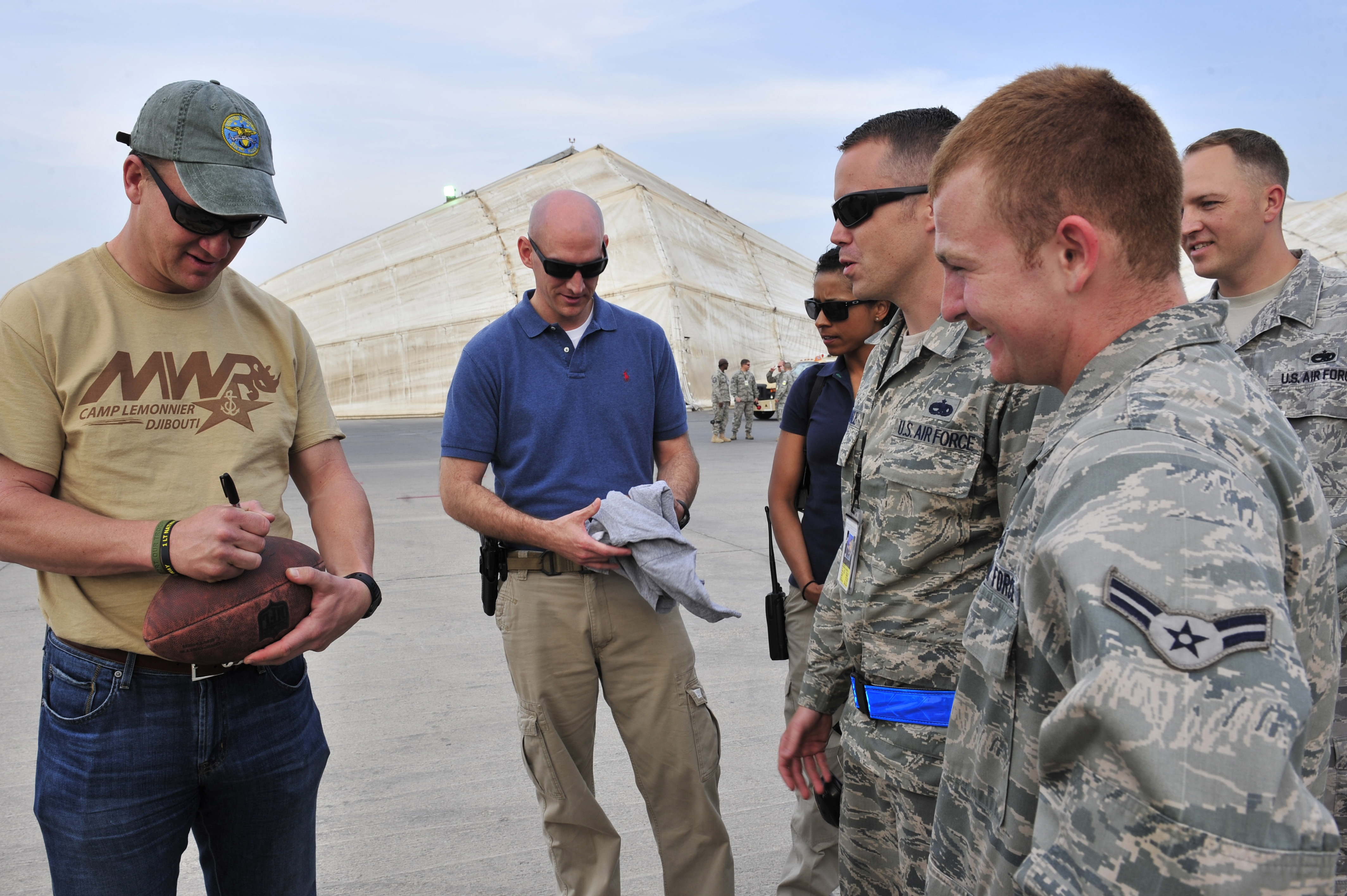 Denver Broncos Quarterback Peyton Manning autographs memorabilia for members of the 380th Air Expeditionary Wing Feb. 28, 2013, in Southwest Asia. (U.S. Air Force photo/Tech. Sgt. Christina M. Styer)