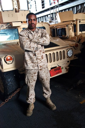 Sergeant Dereck Shockley, anti-tank guided missleman, Combined Anti-Armor Team 1, Weapons Company, Battalion Landing Team 3/5, 15th Marine Expeditionary Unit, poses for a photo in front of his vehicle aboard the USS Rushmore, Feb. 22. The 15th MEU is deployed as part of the Peleliu Amphibious Ready Group as a U.S. Central Command theater reserve force, providing support for maritime security operations and theater security cooperation efforts in the U.S. 5th Fleet area of responsibility. (U.S. Marine Corps photo by Cpl. Timothy R. Childers/ Released)
