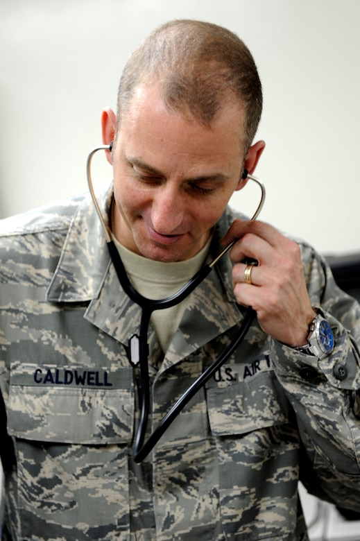U.S. Air Force Tech. Sgt. Douglas Caldwell, Okuma independent medical technician, demonstrates using a stethoscope on Okuma, Japan, Feb. 2, 2013. Caldwell is one of two IDMTs and must overcome the complications that arise when being stationed at a remote location. (U.S. Air Force photo/Airman 1st Class Brooke P. Doyle)