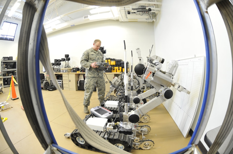 WHITEMAN AIR FORCE BASE, Mo. -- Airman 1st Class Jeff Kinney, 509th Civil Engineer Squadron Explosive Ordinance Disposal team member, performs a function check on the AFMSR and the F-6 robot, Feb. 27. These robots are both designed to destroy improvised explosive devices. (U.S. Air Force photo/Airman 1st Class Keenan Berry) (Released)