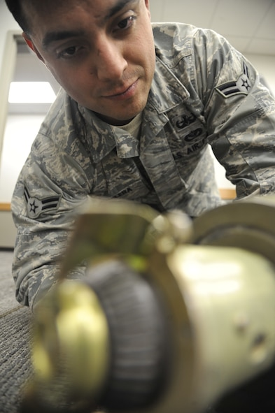 WHITEMAN AIR FORCE BASE, Mo. -- Airman 1st Class Fernando Aguilera, 509th Civil Engineer Squadron Explosive Ordinance Disposal team member, conducts a check of a bomb fuse, Feb. 27. This procedure is important because an EOD member needs to know how to approach, work on and defuse a bomb. (U.S. Air Force photo/Airman 1st Class Keenan Berry) (Released)