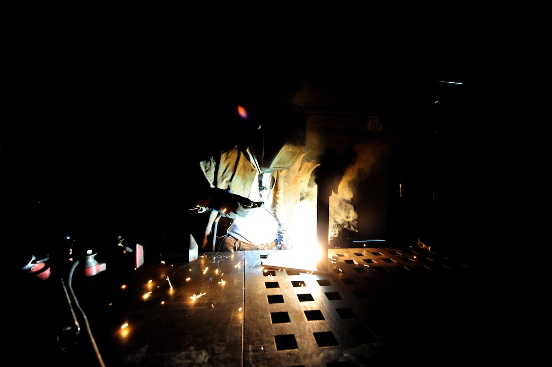 WHITEMAN AIR FORCE BASE, Mo. -- Staff Sgt. Adam Boyd, 509th Civil Engineer Squadron structural supervisor, welds a box blade for a snow plow, Feb. 27.  Structures Airmen perform jobs such as this one to save the Air Force from having to possibly spend money on parts made by civilian companies. (U.S. Air Force photo/Staff Sgt. Nick Wilson) (Released)