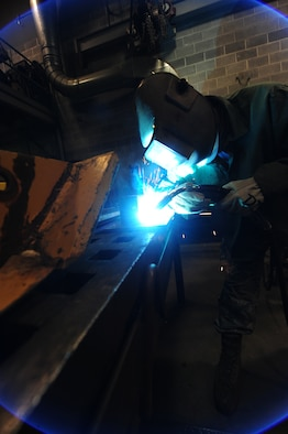 WHITEMAN AIR FORCE BASE, Mo. -- Senior Airman Michael Rafael, 509th Civil Engineer Squadron structural journeyman, welds a box blade for a snow plow, Feb. 27. Structural journeymen are responsible for maintaining knowledge and proficiency in metal layout, metal fabrication, welding, cutting, brazing and lock-smithing. (U.S. Air Force photo/Staff Sgt. Nick Wilson) (Released)