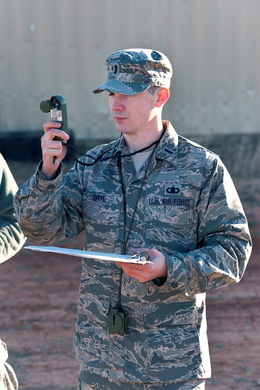1st Lt. Christopher L. Drye, a member of the Texas Air National Guard's 209th Weather Flight, based at Camp Mabry, in Austin, Texas, uses a pocket weather tracker during training at Camp Swift, near Bastrop, March 3, 2013. The training is part of an annual requirement. (National Guard photo by Air Force Staff Sgt. Phil Fountain / Released)