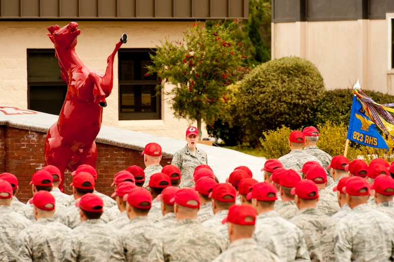 Lt. Col. Ann Birchard, commander of 823rd RED HORSE Squadron, addresses the Airmen of the squadron about recently passed retired Brig. Gen. William Thomas Meredith.  Meredith retired in 1973 and established Air Force organizations such as RED HORSE.  (U.S. Air Force photo by Airman 1st Class Benjamin D. Kim)