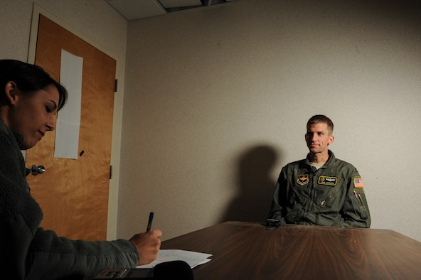 Staff Sgt. Jessica Condit, a 19th Airlift Wing photojournalist, interviews Capt. Jake Johnson, a 48th Airlift Squadron flight commander and pilot, for the Little Rock Snapshot Feb. 26, 2013 at Little Rock Air Force Base, Ark. Johnson was selected to represent the United States Air Force at the 2013 Conseil International du Sport Militaire Cross Country Championship, March 13-18, in Apatin, Serbia.(U.S. Air Force photo by Airman 1st Class Scott Poe)