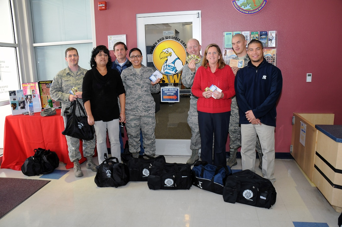 Individual and team biggest loser challenge winners who lost a total of approximately 100 pounds are announced at the Health and Wellness Center, Feb. 28.  Pictured from left to right are: Senior Master Sgt. Jeremy Carney, Graciela Rodriguez, John Jones, Airman First Class Jourdan Varquera, Lt. Jeffrey Campeau, Lisa Blackford, Capt. Albert Tao and Eugene McClelland. The annual competition encourages healthy weight loss and awards prizes to the biggest losers. (Photo by Joe Juarez)