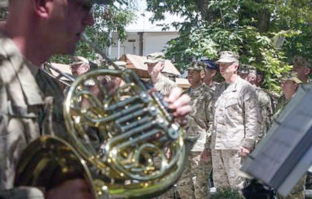 Staff Sgt. Sean Payton, left, plays the French horn during a recent farewell ceremony for Marine Gen. John Allen, who served as commander of coalition troops in Afghanistan. Payton, a member of the 1st Inf. Div. Band, was recently named a recipient of the Finley R. Hamilton Outstanding Military Musician Award.  U.S. ARMY photo.