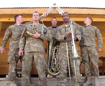 """Staff Sgt. Sean Payton, 1st Inf. Div. Band, second from left, was recently named a recipient of the Finley R. Hamilton Outstanding Military Musician Award. It honors Army, Marine Corps, Navy, Air Force and Coast Guard enlisted musicians who """"exhibit outstanding musical and leadership excellence.""""  U.S. Army photo."""