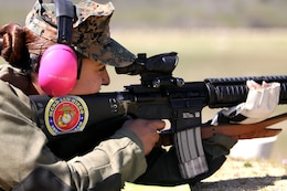 """Cpl. Raquel Martinez fires an M16 A4 service rifle during the Western Division Matches at Wilcox Range here March 6.   """"I won first place for individual rifle,"""" said Martinez, a range coach for Edson Range with Marine Corps Recruit Depot."""