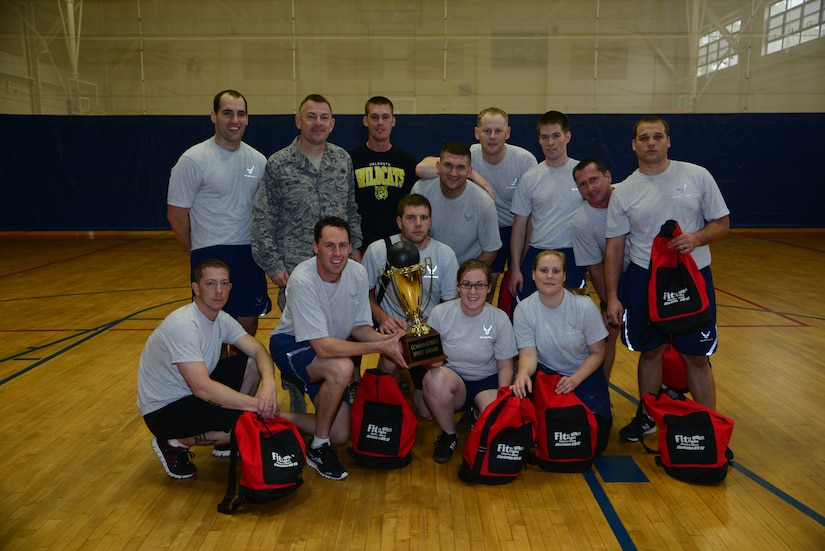 Airmen from the 628th Civil Engineer Squadron gather with Col. Richard McComb, Joint Base Charleston commander, after defeating the 628th Comptroller Squadron in the final game of the Commander's Fitness Challenge dodge ball tournament March 1, 2013, at the Fitness on Joint Base Charleston - Air Base, S.C. The Commander's Challenge is held every quarter to provide friendly competition as well raise esprit de corps. (U.S. Air Force photo/Staff Sgt. Rasheen Douglas)