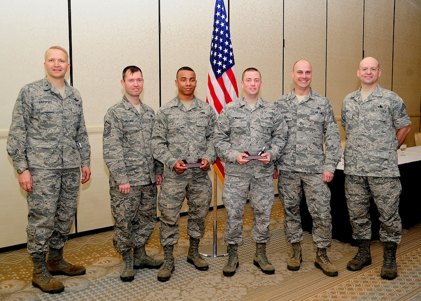 Colonel Darren Hartford 437th Airlift Wing commander (left), and Chief Master Sgt. Gerard Komen, 437th Maintenance Operations Squadron superintendent (right), recognize March's Diamond Sharp winners March 5, 2013, at the Charleston Club at Joint Base Charleston – Air Base, S.C. The Diamond Sharp recipients are (third and fourth from left) Airman 1st Class Gregory Foster, 437th Aerial Port Squadron passenger services agent and Senior Airman Joseph Shewmaker, 437th Operations Group knowledge operations manager. Pictured with the Diamond Sharp winners are Master Sgt. Jeremy Klemme, 437th APS first sergeant and Master Sgt. Brett Hopkins, 437th OG first sergeant. Diamond Sharp awardees are Airmen chosen by their first sergeants for their excellent performance. Not pictured here but also a recipient of this month's Diamond Sharp award are Airman 1st Class Cole Lane, 14th Airlift Squadron loadmaster and Staff Sgt. Lee Vearrier, 16th Airlift Squadron loadmaster evaluator special operations level II. (U.S. Air Force photo/Staff Sgt. Rasheen Douglas)